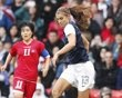 Alex Morgan of the U.S. controls the ball during their women's football first round Group G match against North Korea at Old Trafford in Manchester during the London 2012 Olympic Games