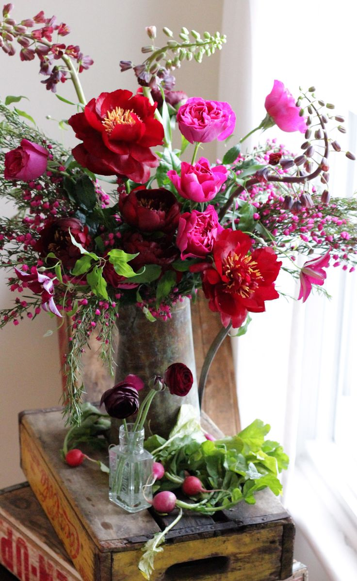 Flowers by Sachi Rose. (Rustic, farm to table, barn, wood crates, vintage, radishes, peonies, garden roses, ranunculus, country wedding, wild, organic, floral arrangement)