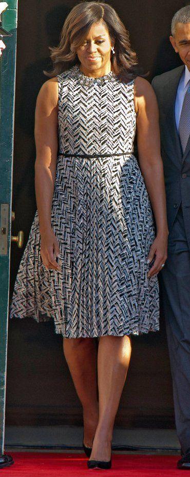 Michelle Obama in Giambattista Valli greets the Prime Minister of Italy.