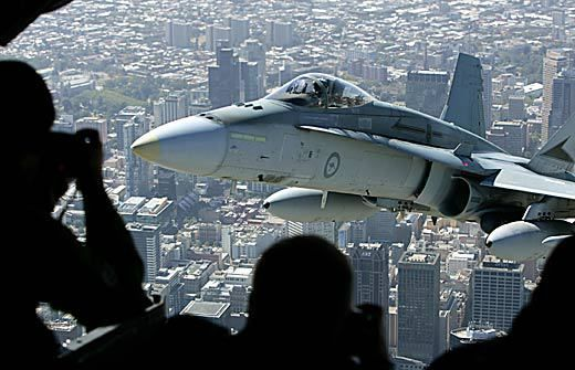 The crew of an RAF C17asked the pilot of an RAF F/A-18 hornet to come close for a photo @ cargo bay door.