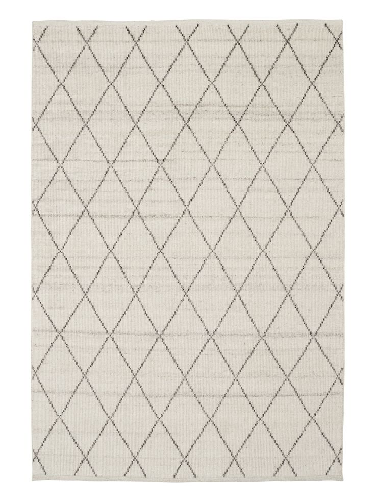 Taking its cue from traditional Moroccan beni ourain rugs, this simple diamond pattern is hand knotted into a low pile of soft, natural tones