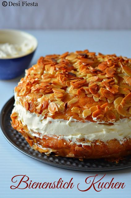 Bienenstich Cake - German yeast cake filled with custard or pastry cream and frosted with honey, butter and almonds