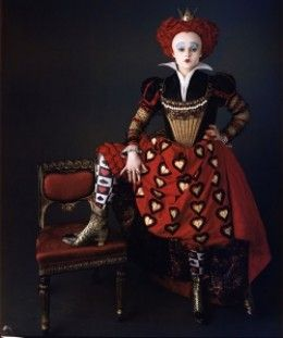"""Although red hearts are normally associated with kindness and love, this queen is the opposite of good. She is not reasonable, mean, nasty, and short tempered. The Red Queen rules Wonderland with her strict ways. One of her favorite quotes is, """"off..."""