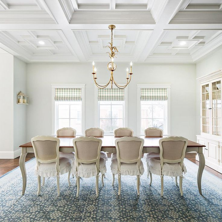 Breathtaking dining room design by The Fox Group. French Bergere chairs surround a French country dining table. Check pattern on roman blinds and dramatic coffered ceiling. Muted palette and serene mood. #thefoxgroup #diningroom #Frenchcountry #timless