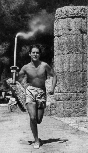 Constantine Kondyllis runs the first leg of the very first Olympic torch relay from Olympia to Berlin in 1936.
