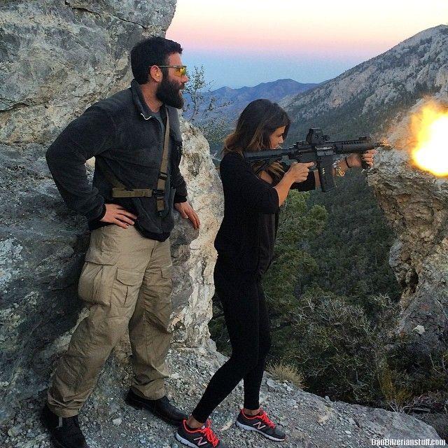Hiking is always more fun with a machine gun @erikaross_   Dan Bilzerian Stuff - Girls, Guns and Supercars