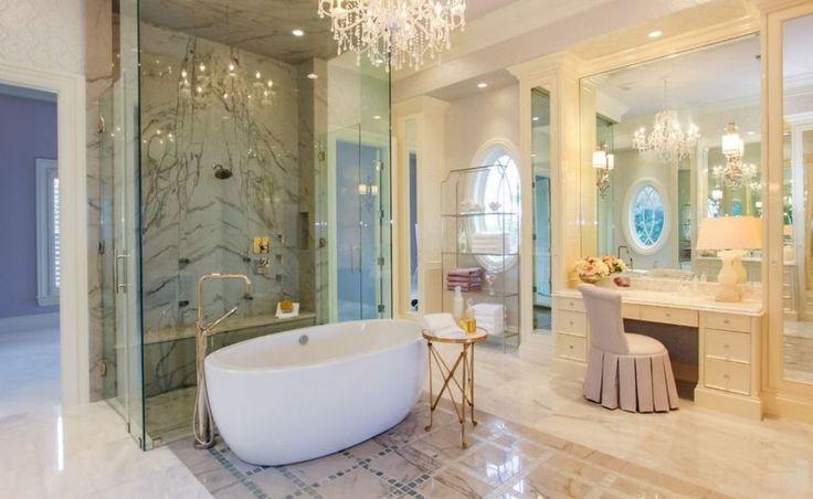 Modern Luxury Bathroom Ideas With White Ceramic Oval Tub And Sparkling Crystal Chandelier Using Elegant Vanity Bench, Copper Bathroom Faucets, #luxuriousbathrooms #bathroomremodel #interiordesignideas #interiordesigninspiration #interiordesigns #homeimprovement #chandelier