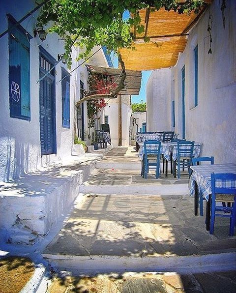 Colorful alley with a traditional Greek tavern inside the Chora village , at Amorgos island (Αμοργός)❤️. Fantastic island with natural beauty and impressive villages !