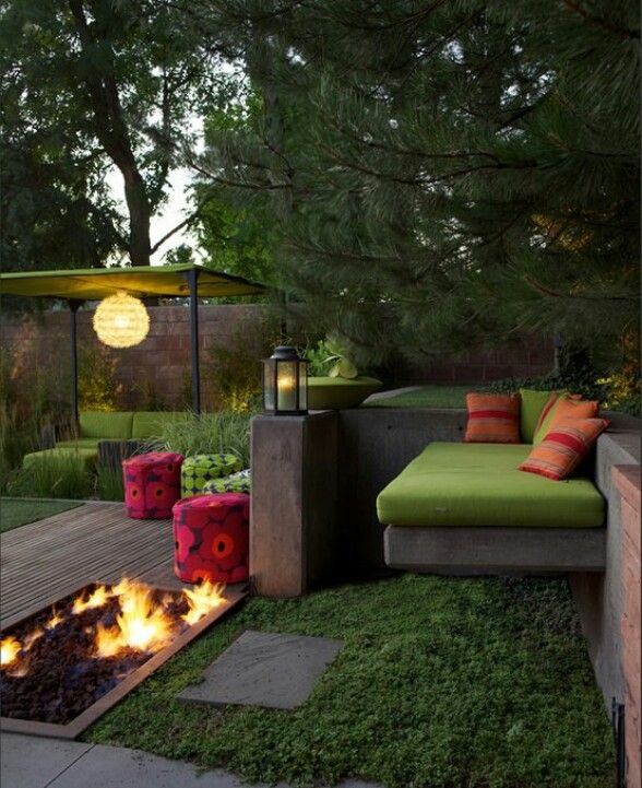 Inviting outdoor space and fire pit love the deck around surrounding the fire pit