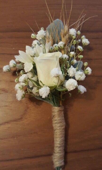 Groom's bout of white spray rose, white mum, baby's breath, wheat and dusty miller. Stems wrapped with jute.  www.facebook.com/perfectpetalsweddingsandeventsflorist