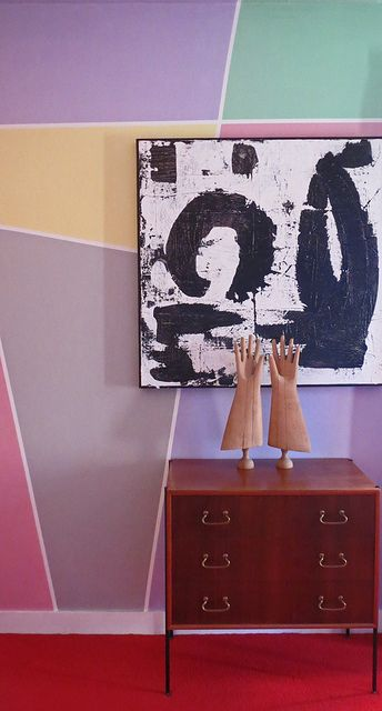 Eclectic Assemblage: Geometric walls and black and white abstract painting.