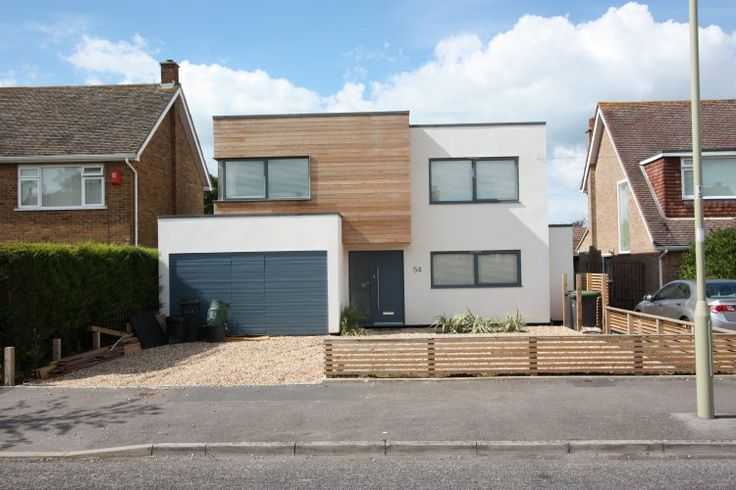 Remodelled house comprising projecting and cantilevered cubes in contrasting materials.