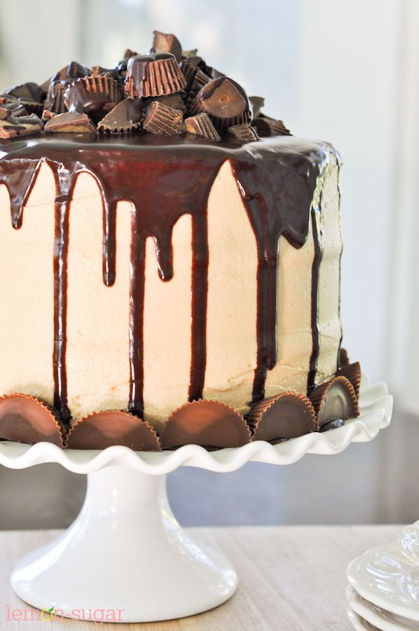 The Ultimate Peanut Butter Cup Chocolate #Cake recipe - #Chocolate cake frosted with creamy peanut butter frosting, topped with a silky chocolate ganache and TONS of peanut butter candies.