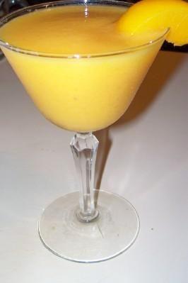 Frozen Peach Daiquiri (3 large fresh peaches  3 Tbs sugar 1/2 cup light rum 2 Tbs fresh lime juice 3 cups crushed ice)