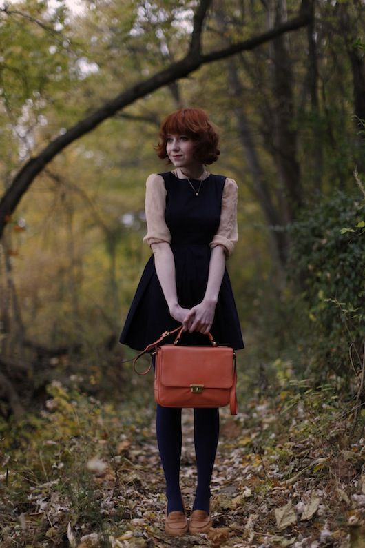 Dark A-line pinafore, neutral button down, red satchel. You really can't go wrong with that.