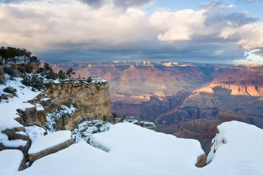 """Southern rim of the Grand Canyon covered in snow, """"why winter is the best time to explore US deserts"""""""