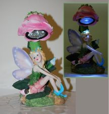 Solar Fairy Light Statue with Wings & Pink Rose This elegant solar fairy light statue adds a colorful touch to any garden or patio. http://www.mysolarshop.com/solar-fairy-light-statue-sw0020