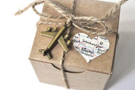 These travel theme wedding favor boxes come with an adorable little airplane charm, twine, and a little heart cut from a vintage map.  These
