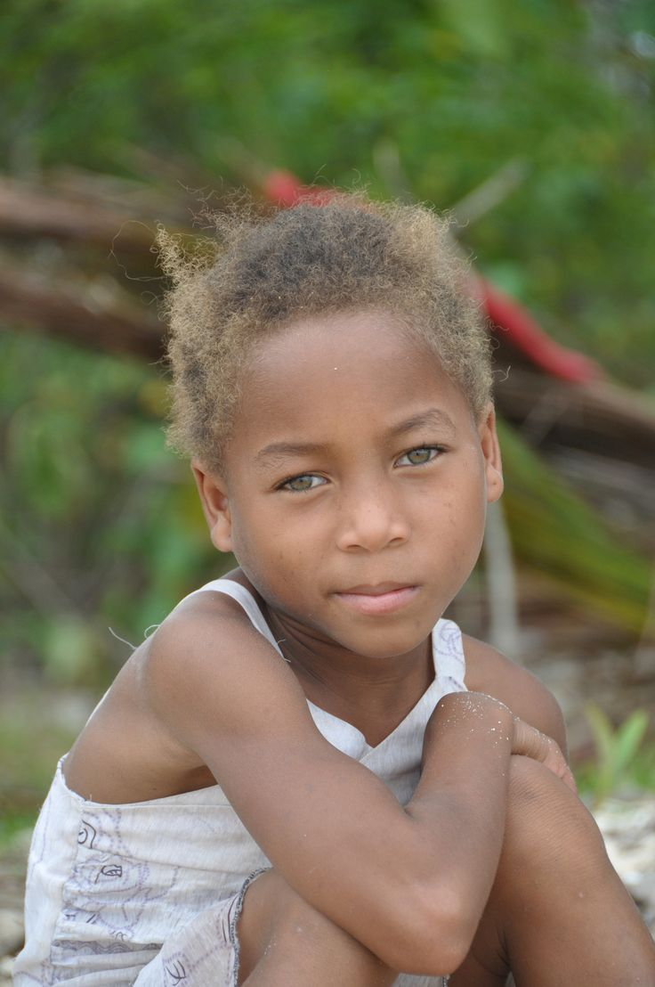 https://flic.kr/p/mAPgov   Being shy 1   She was playing with another girl. She didn't know if she wanted her picture taken. I like the look on her face. Mananara, Eastern Madagascar 2013