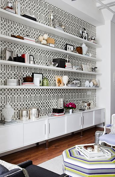 Add a Splash of Color For visual interest, back your shelves with a contrasting wallpaper print or colorful paint. This gorgeous bookcase by Samantha Pynn {decorator, stylist and host and principal designer of Pure Design on HGTV} is backed with Schumacher's Imperial Trellis by Kelly Wearstler  in Charcoal.: