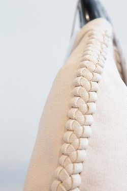 § DELPOZO. making knit pieces with long tendrils at the end that you plait together as seam finishes
