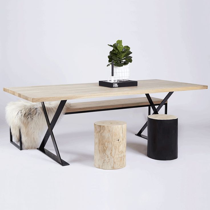 The Alexandria Dining Table is made with a solid Elm wooden and timber top with black powder coated steel metal legs. Featured here are the log stools and Alexandria Dining Bench.