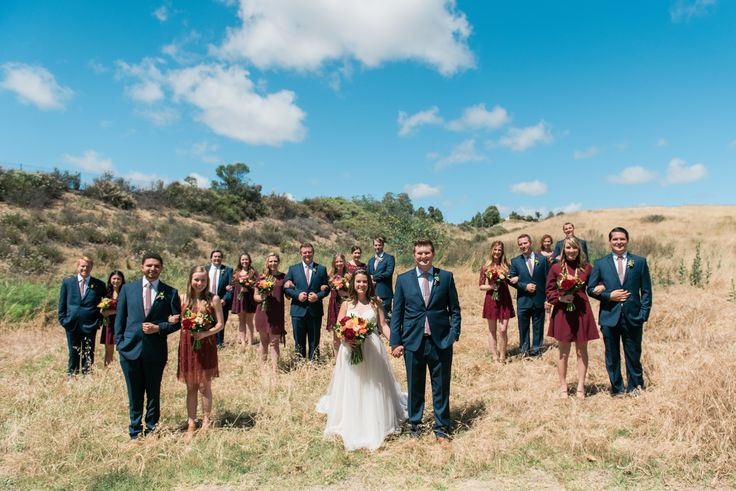 BOHEMIAN BREWERY WEDDING   Bridal party photos in nature the best! We love this adventurous bride and groom, and think the marsala (burgundy) bridesmaids dresses and navy suits stand out amazingly on this backdrop!