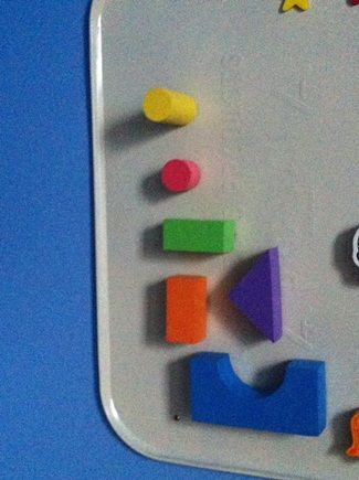 glue magnets onto foam or wooden blocks and use with a magnetic board or white board for a vertical building experience