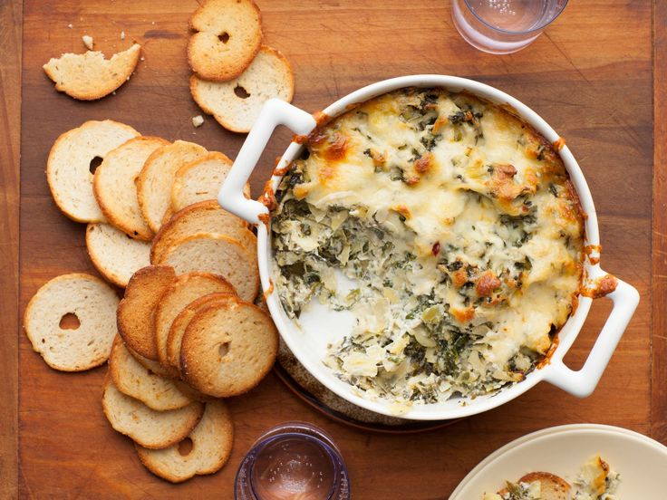 Get this all-star, easy-to-follow Hot Spinach-Artichoke Dip recipe from Paula Deen