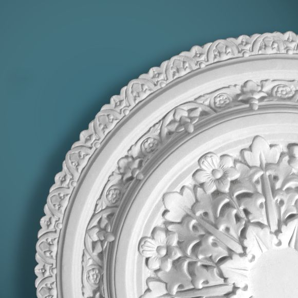 CP54 is an incredibly popular Victorian plaster ceiling rose, suitable for mid-sized to large rooms.  Restored and remoulded from the original this rose is beautifully detailed with a leaf and flower design and a bevelled outer edge.  Dimensions:-  Diameter:-750mm  The plain centre section:-86mm.  Depth:-68mm.
