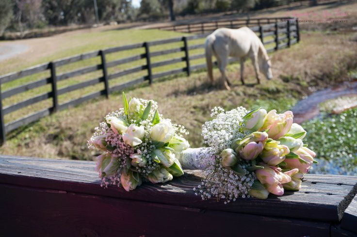 Tulips and babies breath wedding bouquets. Flowers: A Happily Ever After Floral