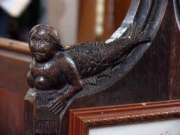carved pew end