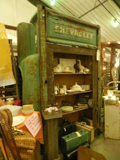 Truck Bed repurposed into a pantry/display shelf - super cool!   (vendor at Farm Chicks Show 2012)