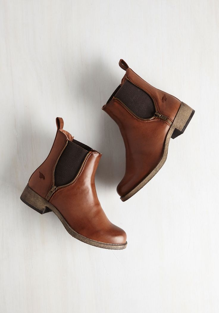 Casual Influence Boot. Ever since you slipped into the laid-back style of these cognac-hued Rocket Dog booties, youve assembled more low-key looks to accompany them. #brown #modcloth