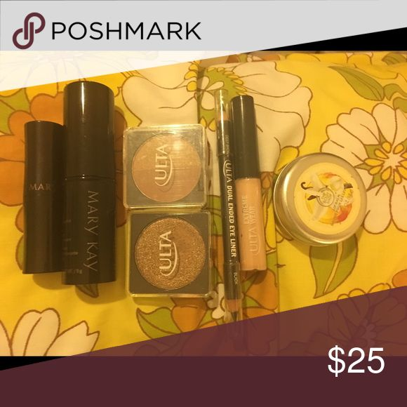 """Mary Kay and Ulta Make up lot Lot includes: full size cooling, bronzing stick by Mary Kay, full size Mary Kay lipstick in """"Sunlit Sand"""" (tried once), Ulta unopened sun kissed blush/bronzer duo, glitter top eye shadow top coat in """"Bronze Bombshell"""" (tried once), Ulta dual ended eye liner in deep brown/black (sealed), Ulta extreme wear eye shadow primer (sealed), and body shop lip balm (tried once) in Vanilla Brûlée. Opened items have been cleaned and sanitized. Great lot! Mary Kay Makeup…"""