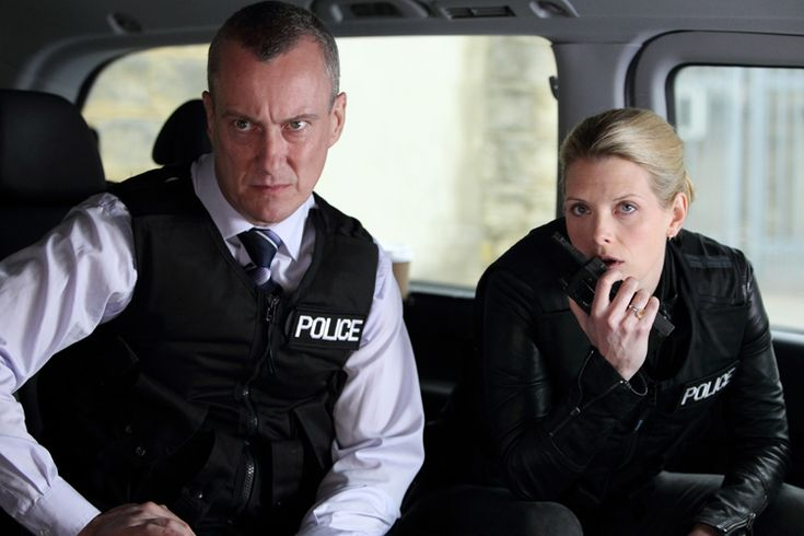 """DCI Banks (Stephen Tompkinson) and DS Annie Cabbot (Andrea Lowe) in a still from the dramatic TV series about British detectives, """"DCI Banks."""" (Courtesy of WPBT2)"""