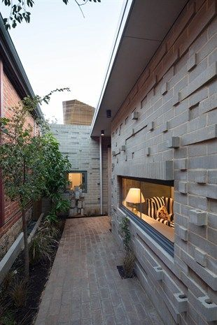 Claremont origami house. Blocks turned sideways to create mini planters in the walls