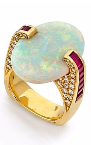 AN OPAL, DIAMOND AND 18K YELLOW GOLD RING, BY SCAVIA - Don't be tricked when buying fine jewelry! Follow the vital rules at http://jewelrytipsnow.com/a-simple-guide-to-purchasing-fine-jewelry/
