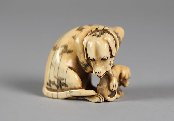 Netsuke of Dog and Puppy, 19th century. Japan. The Metropolitan Museum of Art, New York. Gift of Mrs. Russell Sage, 1910 (10.211.634).
