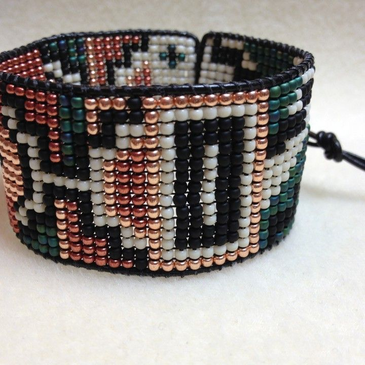 Tribal Cuff from TweedleBead for $95.00. Gorgeous beadwork!  I have been eyeing this designer for awhile now.  http://mkt.com/TweedleBead