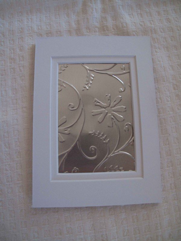 embossed picture made with roof flashing and a Cuttlebug machine.