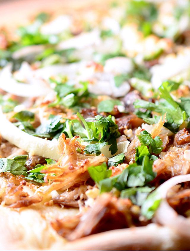 Pulled pork, onions, jalapenos, cojita cheese, cilantro and a hint of lime. This pizza just might change your life. Maybe add caramelized onions?