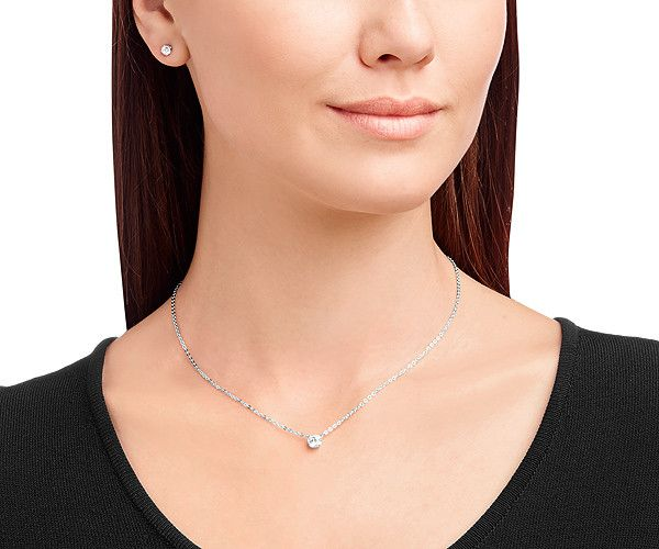 The Attract Round Set is truly understated elegance and a timeless essential. This necklace and earring set would make a perfect bridal or bridesmaid gift.  Available at Swarovski.