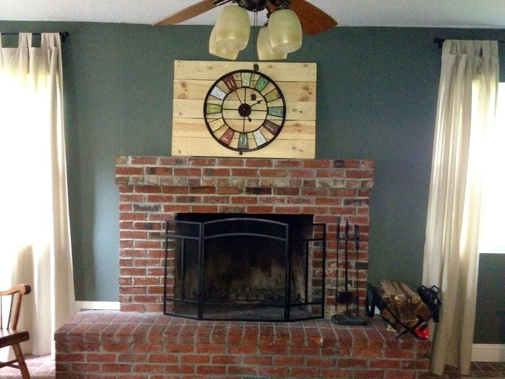 Red Brick fire place.  An idea for teal-gray in combination with traditional red brick just for something different from tan.