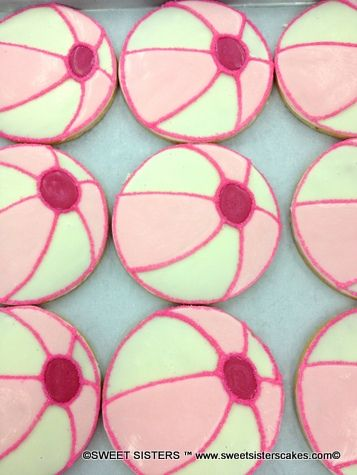These pink beach ball cookies are great for an outdoor beach party! #desserts #cookies #summer #summertime #beach #beachball #pink #SweetSisters
