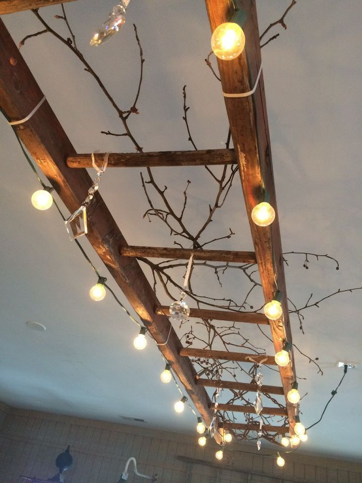 A vintage wooden ladder makes great track lighting! #homelighting #homeresalevalue