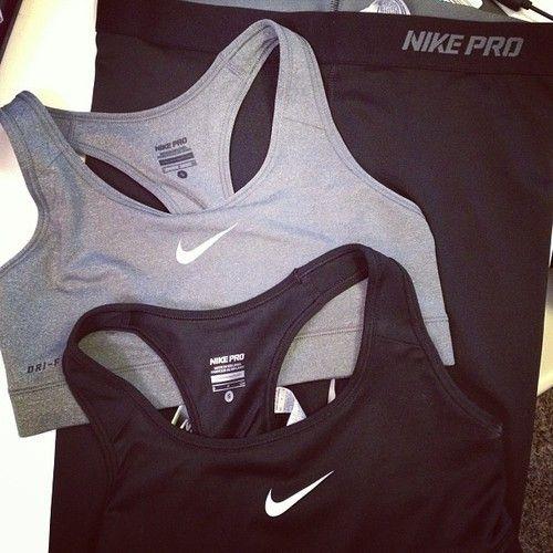Black and grey nike sports bras