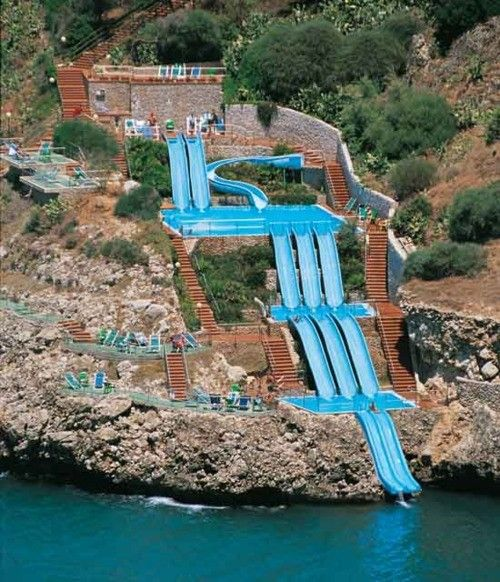 a superslide into the Mediterranean Sea; Sicily, Italy. This would be so fun, and think of the exercise you could get climbing all those stairs to get back up there. haha