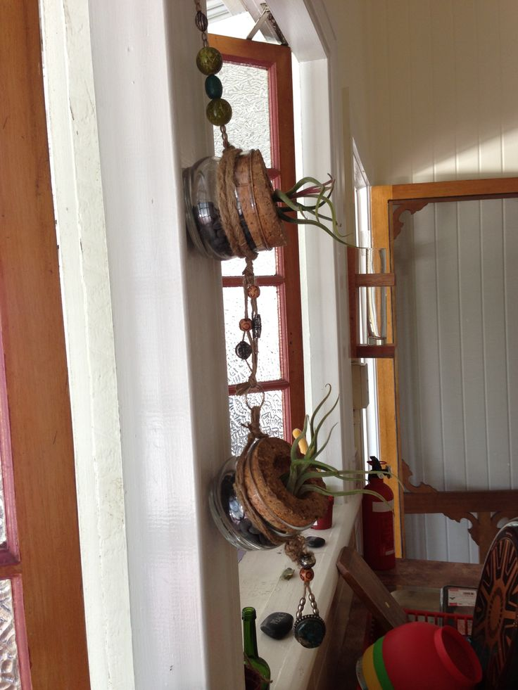 I made my hanging pots for my air plants... Finally!! Bought the jars from an op shop... The beads I had at home and just some good old twine...
