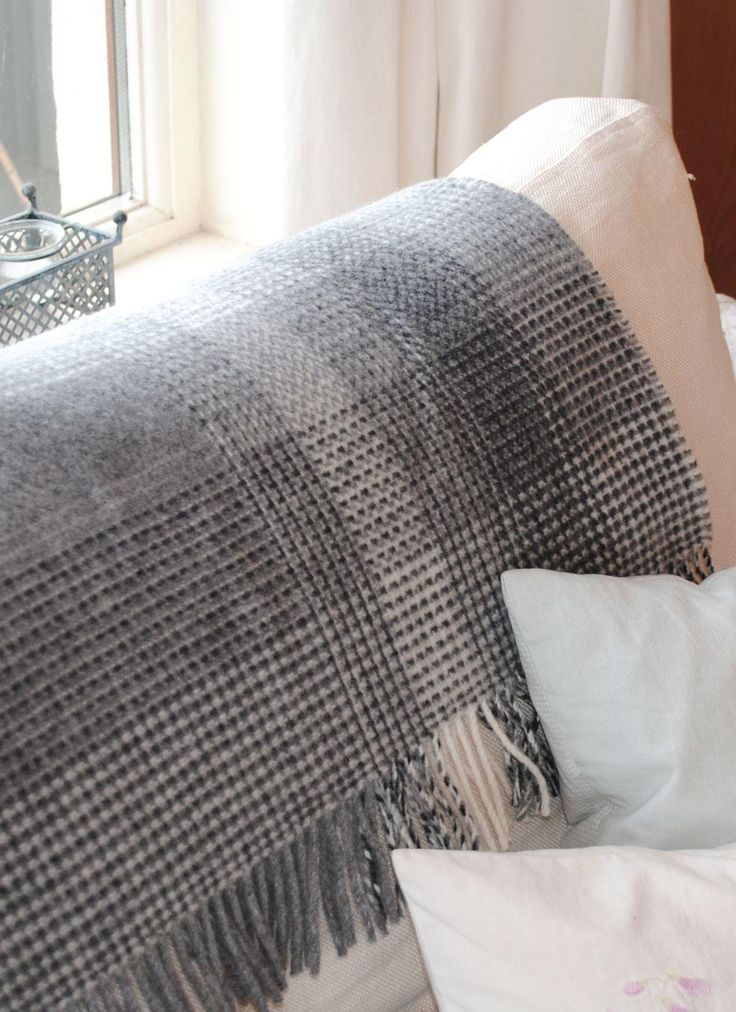 Gray and Cream Wool Cashmere Throw: Woven from 5% cashmere and 95% wool this beautifully soft throw, with fringing at either end, is the ultimate in luxury.The grey and cream tones give this beautiful piece a modern and contemporary feel. #graythrow #greythrow #throw #blanket #throwblanket #woolthrow #woolblanket #cashmerethrow #cashemereblanket #cashmere #wool #gray #grey #home #homedecor #'homeaccessories #irish #sittingroom #bedroom